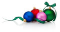 Colored Christmas baubles with ribbon bow  on white Royalty Free Stock Photo