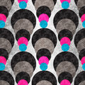 Colored circles on a gray background with illumination. Seamless geometric pattern.