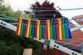 Colored clothespins close up of a on a clothesline Stock Photo