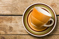 Colored coffee cup with saucer top view of empty on wooden rustic table Royalty Free Stock Photo