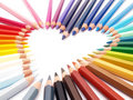 Colored crayons show heart-shape Stock Photos