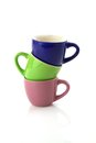 Colored cups on on top of other  Stock Photography