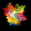 Colored dust freeze motion of explosion on black background Stock Image