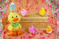 Colored easter chicks duckling a yellow and are romping around Stock Photography