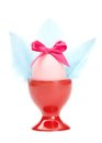 Colored easter egg with pink bow and blue wings Stock Image
