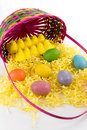 Colored easter eggs chicks and basket pastel yellow marshmallow pink yellow green Royalty Free Stock Photo