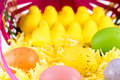 Colored easter eggs chicks and basket pastel yellow marshmallow pink yellow green Royalty Free Stock Photos