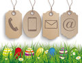 Colored easter eggs grass carton price stickers contact green with and on the wooden background Royalty Free Stock Photos