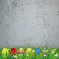 Colored easter eggs grass concrete green with on the background Stock Photography