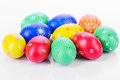 Colored easter eggs multi painted by hand wooden texture on white Stock Images