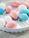 Colored Easter Eggs on white plate, toned Royalty Free Stock Images