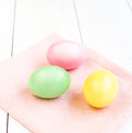 Colored easter eggs on white wooden background boiled Royalty Free Stock Images