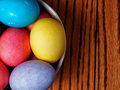 Colored easter eggs on a wood table Stock Photos
