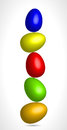 Colored eggs balancing in equilibrium Royalty Free Stock Photo