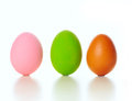 Colored eggs different and quail egg on white Royalty Free Stock Photos