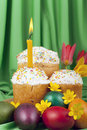 Colored eggs and Easter cakes with a lit candle Royalty Free Stock Photo