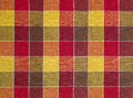 Colored fabric with colorful red and yellow squares Royalty Free Stock Image