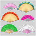 Colored fan items for women fans on a gray background Stock Image