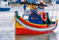 Colored fishing boat malta in marsaxlokk harbor Royalty Free Stock Photos
