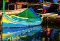 Colored fishing boats malta in marsaxlokk harbor Royalty Free Stock Images