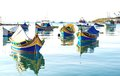 Colored fishing boats malta in marsaxlokk harbor Stock Images
