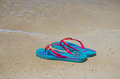 Colored flip-flops on the beach Royalty Free Stock Image