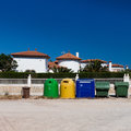 Colored garbage bins to help separate recycle Royalty Free Stock Image