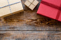 Colored gift boxes on wooden background top view copyspace