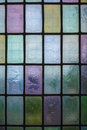 Colored glass window with block pattern background multicolored stained regular in hue of blue green violet Stock Photography