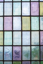 Colored glass window pattern blue green tone multicolored stained with regular block in hue of violet Stock Images