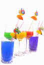 Colored glasses with alcoholic drinks isolated on white Stock Images