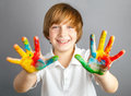 Colored hands smiling child showing his Royalty Free Stock Photo