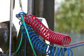 Colored hoses connection of big semi truck bracket on the spring which suspended the red blue and green air and wires to connect Royalty Free Stock Images
