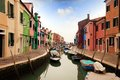 Colored houses of burano island and canals in laguna nord venice Stock Image