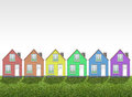 Colored houses on the green meadow Stock Image