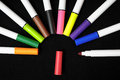 Colored ink markers some on a black background Royalty Free Stock Photos