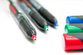 Colored liners red green and blue and lids on white background Stock Photo