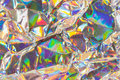 Colored metallic background detail close up of wrinkled paper as a colorful structured image in soft colors with focus at the Stock Photo