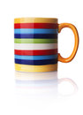 Colored mug isolated on the white background Royalty Free Stock Photography