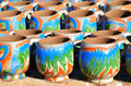 Colored mugs handmade cups from in a moroccan pottery workshop Royalty Free Stock Images