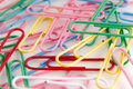 Colored paper clips on white Royalty Free Stock Images