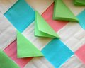 Colored paper napkins white blue pink and green colours are collected in ornament Stock Image