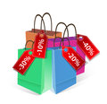 Colored paper shopping bag with discount labels on white background Royalty Free Stock Photo