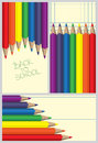Colored pencil frames a set of three pencils background with space for your message and handwritten back to school Royalty Free Stock Photos