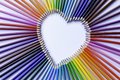Colored pencil rainbow heart on slant close up Stock Photos