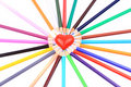 Colored pencils around heart Royalty Free Stock Photos
