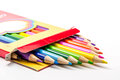 Colored pencils art school in box on white background Royalty Free Stock Photo