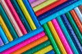 Colored pencils background with drop of water Royalty Free Stock Photo
