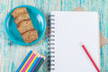 Colored pencils and book note on desk Royalty Free Stock Photo