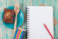 Colored pencils and book note Royalty Free Stock Photo